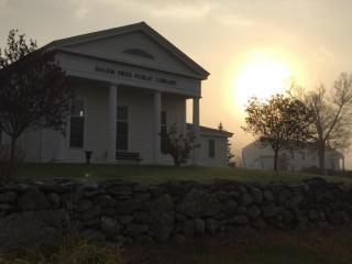 Hazy early morning sun shining at the Salem Free Public Library